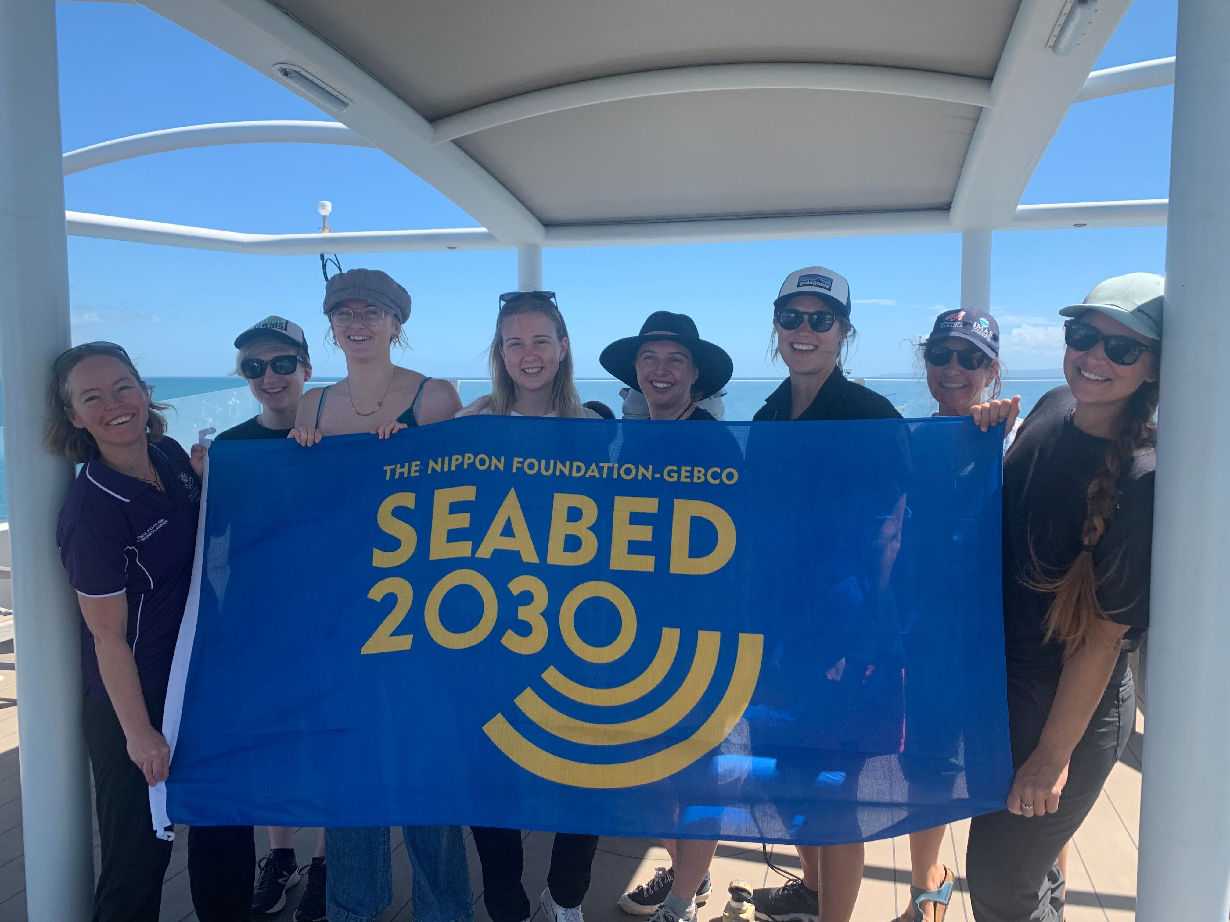 2 Science party holding Seabed 2030 Flag